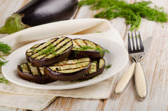 Grilled eggplant slices on a wooden table Royalty Free Stock Photos
