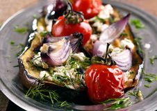 Grilled eggplant with vegetables and cheese Royalty Free Stock Photography