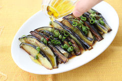 Grilled eggplants with oil and onion on white platter Royalty Free Stock Photography