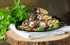 Grilled eggplants rolls with nuts, cheese, garlic and herbs and pomegranate seeds, georgian cuisine stock images