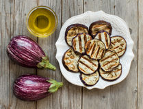 Grilled eggplants seasoned with olive oil Stock Photos