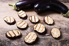 Grilled eggplants seasoned Stock Photos