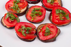 Grilled eggplants with tomatoes Royalty Free Stock Photo