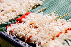 Grilled Enoki Mushroom Wrapped with Slice of Crab Sticks Stock Photo