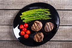 Grilled filet mignon with asparagus and tomatoes. Beef sreak on rustic background stock photos