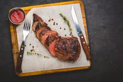 Grilled filet mignon steak, herbs and spices. Top view stock images