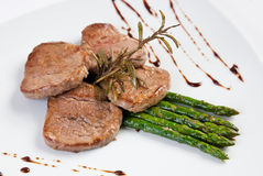 Grilled fillet with asparagus Royalty Free Stock Images