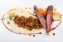 Grilled fillet of lamb with thyme polenta, vegetables and gravy Stock Image