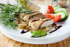 Grilled Fillet Lemon Sole With Onion Royalty Free Stock Image
