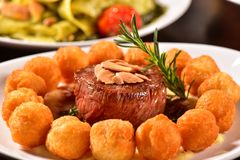 Grilled fillet steak and potatoes Stock Photos