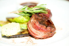 Grilled fillet mignon wrapped in bacon close up Royalty Free Stock Images
