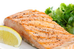 Grilled fillet of salmon on plate with green salad Stock Photo