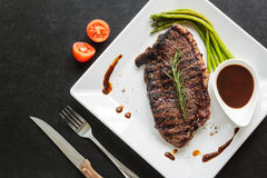 Grilled fillet steak with asparagus and tomato ready to served Royalty Free Stock Photography