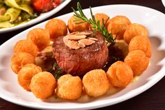 Grilled fillet steak and potatoes Royalty Free Stock Photo