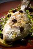 Grilled Fish. Big Grilled Fish with Lemon Stock Image