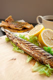 Grilled fish. And lemon with shallow depth of field stock photography