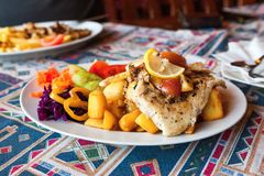 Grilled fish with apple and vegetable Stock Photo