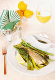 Grilled fish and asparagus on the plate Stock Photo