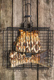 Grilled fish in barbecue Royalty Free Stock Images