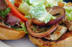Grilled fish burger with Caesar, shallow DOF Royalty Free Stock Photography