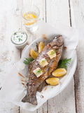 Grilled fish. With butter and lemon, selective focus Royalty Free Stock Images