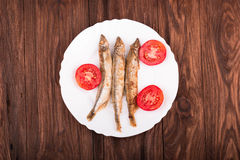 Grilled fish capelin Stock Photos
