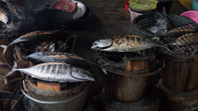 Grilled fish on charcoal stove Stock Image