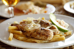 Grilled fish and chips on a plate, shallow DOF Royalty Free Stock Photo