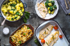 Grilled fish fillet with potato and salad Royalty Free Stock Image