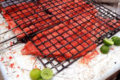 Grilled fish fillet red achiote sauce Mayan Royalty Free Stock Photos