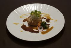 Grilled fish fillet served with fusion sauce. On a white plate stock photo