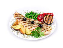 Grilled fish fillet with tasty vegetables. Stock Photos