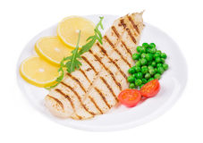 Grilled fish fillet with vegetables. Royalty Free Stock Image
