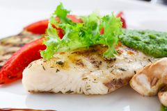 Grilled fish fillet with vegetables Royalty Free Stock Photos