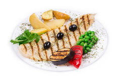 Grilled fish fillet with vegetables. Royalty Free Stock Photography