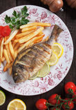 Grilled fish fith french fries Stock Photos