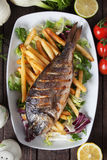 Grilled fish with french fries Stock Photography
