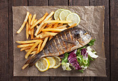 Grilled fish with french fries and salad Royalty Free Stock Photography