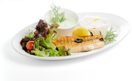 Grilled fish with garnish ris Royalty Free Stock Image
