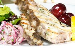 Grilled fish with grapes Stock Photos