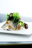 Grilled fish with greens. And rice royalty free stock photography