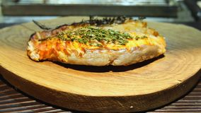 Grilled fish, grilled salmon steak with the addition of aromatic spices, close-up, 4k. Grilled seafood.