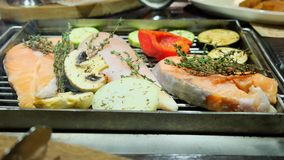 Grilled fish, grilled salmon steak, chicken, aromatic spices and grilled vegetables steak, close-up, 4k.