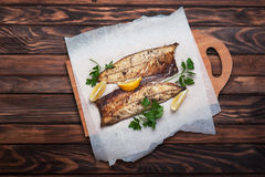 Grilled fish with herbs and lemon Stock Image