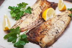 Grilled fish with herbs and lemon Royalty Free Stock Photos