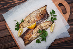 Grilled fish with herbs and lemon Stock Photo