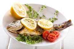 Grilled fish with lemon Royalty Free Stock Image