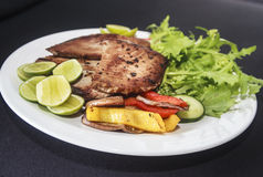 Grilled fish meal on the plate. Stock Photo