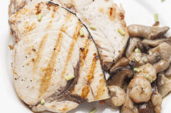 Grilled fish with mushrooms Royalty Free Stock Photo
