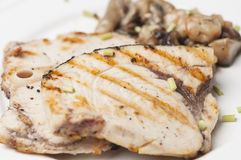 Grilled fish with mushrooms Stock Photo